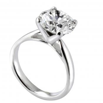solitaire ring with a brilliant cut diamond set in 4 heavy square prongs on a roof-shaped shank with palmettes