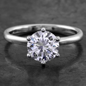 handmade solitaire ring with a brilliant cut diamond set in 6 prongs rounded setting made of round wire