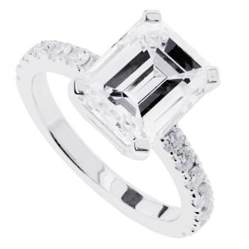 裸钻钻戒:祖母绿型切割diamond on a straight band set with smaller brilliant cut diamonds on the side