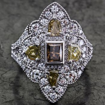 ring with a central fancy brown diamond flanked by four epaulet cut diamonds finished with pavé set brilliants