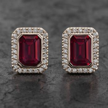 halo earrings with central emerald cut rubies bezel set and surrounded with castle set smaller brilliant cut diamonds and Alpa poussets