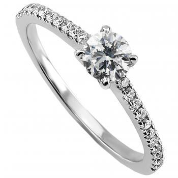 solitaire ring with a central brilliant cut diamond with smaller diamonds on the side castelsetted a finer band