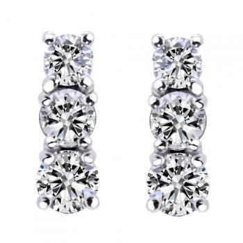 earrings with three descending diamonds set with four prongs or claws and with tige poussette or clutch back system