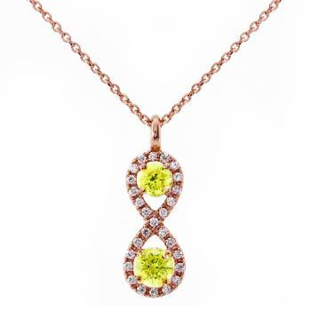 infinity pendant with treated lime colored diamonds surrounded by castelsetted brilliant cut diamonds