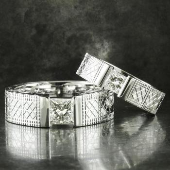 slim soltairering ring with a princess cut diamond on a band engraved by hand with different motives