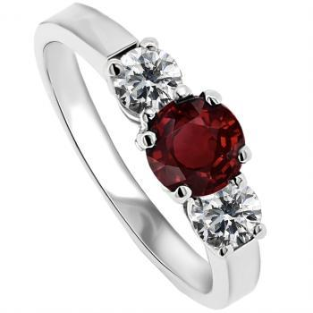 trilogy ring with a central ruby and brilliant cut diamonds wtih 3 prongs for the stones on the side
