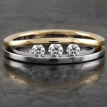 wedding ring with three brilliant cut diamonds chanel set between two equally wide bands