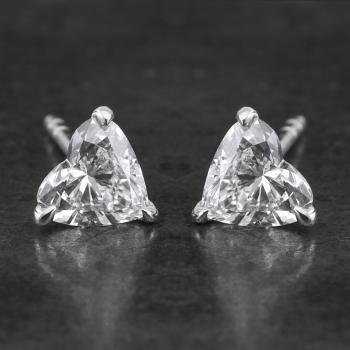 solitaire earrings or studs with heart cut diamonds set with three claws and fitted with a poussette system