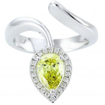 entourage ring with fancy vivid Yellow pear cut diamond surrounded by smaller brilliant cut diamonds
