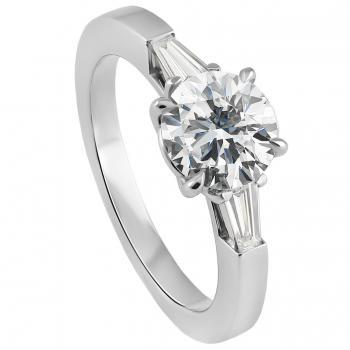 solitaire ring with a central brilliant cut diamond and beside which two tapered baguettes