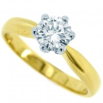 solitaire ring with a brilliant cut diamond set with six prongs mounted on a rounded schank