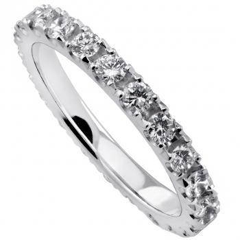 anniversary ring with brilliant cut diamonds castle set with some more space between the diamonds