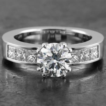 solitaire ring with central brilliant cut diamond set in four double claws and chanel set princess cut diamonds on the side