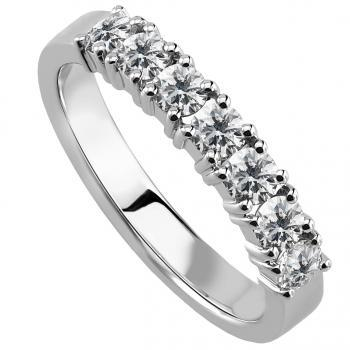 wedding ring with brilliant cut diamonds set with four prongs per diamond