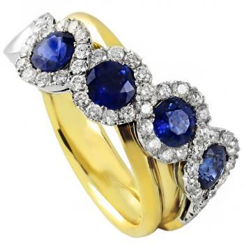 halo ring with four round Ceylon sapphire surrounded by brilliant cut diamonds overlayed on a yellow gold band