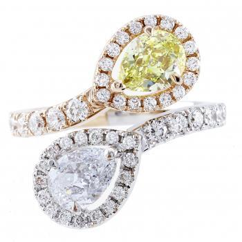 toi et moi halo ring with a fancy yellow and white pear shaped diamond surrounded by smaller brilliant cut diamonds