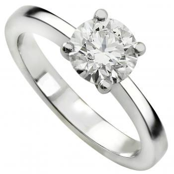 Handmade solitaire ring with a brilliant cut diamond set into four prongs in a conical basket