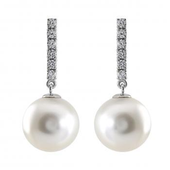 pearl earrings with round white South Sea pearls moving on a row of six brilliant cut diamonds set with prongs