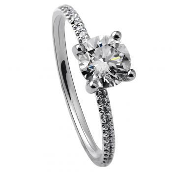 handmade solitaire ring with a larger brilliant cut diamond and castle pavé set side stones on the band wearable together with a wedding band