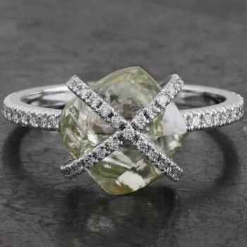 engagement ring with a green natural rough diamond surrounded by two bands of pavé-set brilliant cut diamonds