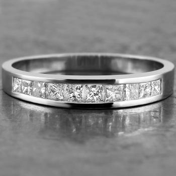 wedding ring diamond band for about one third channel set with princess-cut diamonds descending in size