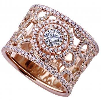 ring with small rings and central diamond set in double entourage