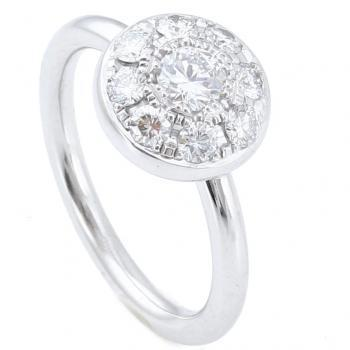 pavé ring with brilliant cut diamonds on a rounded disc on a round band