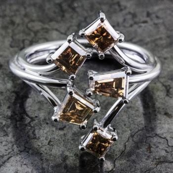 ring with five fancy brown fancy shaped diamonds set with four prongs on a round wire structure