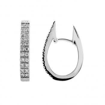 oval and on top straighter creol earrings with a rectangular profile and two lines of brilliant cut castel set diamonds