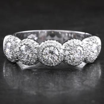 halo alliance ring with larger brilliant cut diamonds set in rounded pots or donuts surrounded by smaller brilliant cut diamonds