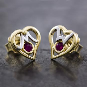 handmade solitaire earrings with a cabochon cut ruby in a yellow box and left a white M and a right a W surrounded by a heart-shaped frame designed Walter & Molly