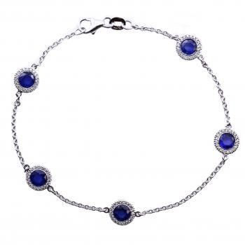 halo bracelet with ceylon sapphire & smaller brillant cut diamonds around