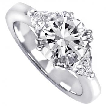 solitaire ring with a central brilliant cut diamond with 2 tirangle cut diamonds on the side
