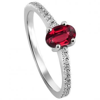 handmade solitaire ring with a central oval ruby with smaller brilliant cut diamonds castle set aside on a slim band