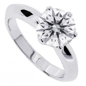 solitaire ring with a brilliant cut diamond set in a slightly curved setting
