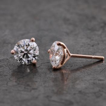 handmade solitary earrings for brilliant cut diamonds set in three rounded conical prongs and with poussettes or nuts