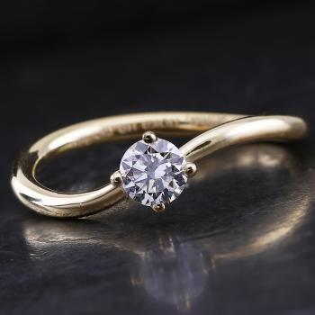 handmade solitaire ring with a brilliant cut diamond in a curved twisted setting with four prongs