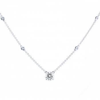 necklace with a brilliant cut central diamond and smaller diamonds set in donut-pots in chain
