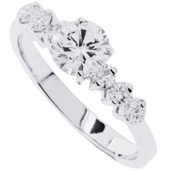 ring with a central brilliant cut diamond and smaller diamonds on the side all set with prongs