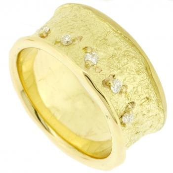 wide candle edged ring with small brilliant cut diamonds