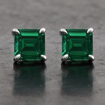 solitaire earrings with radiant cut emeralds set with four claws and with a pin with alpa system