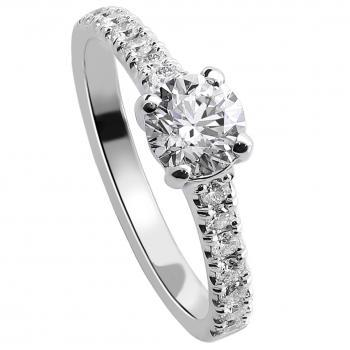 solitaire ring with a brilliant cut diamond  and smaller castle set diamonds on the side