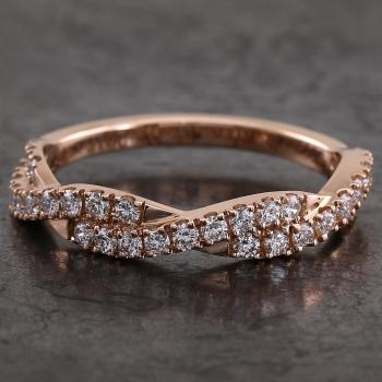pavé ring braided or crossed over half castle set with brilliant cut diamonds