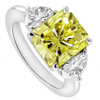 ring with cut-corner rectangular mixed cut  fancy yellow diamond and two heart cut diamonds aside
