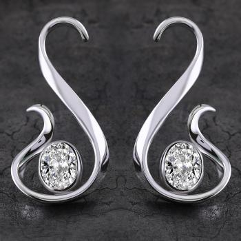 long dynamic earrings with oval cut diamonds