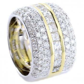 pavé ring with one row of channel set pricess cut diamonds flanked by two rows of pavé set brilliant cut diamonds