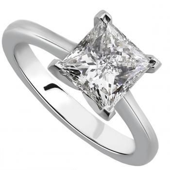 handmade solitairering with a princess cut diamond set in four square prongs on a shank with small palmets