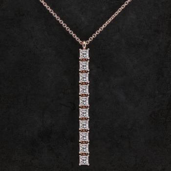 pendant with princess cut diamonds set with four pongs and attached with fine moving parts pending on a small ring
