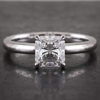 handmade solitaire ring with a radiant cut diamond set in four claws rounded setting made of round wire