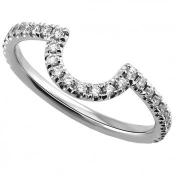 wedding ring with a round profile adjacent to an engagement ring pavé set with brilliant cut diamonds